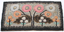 FLORAL HOOKED RUG BY MOLLY NYE TOBY