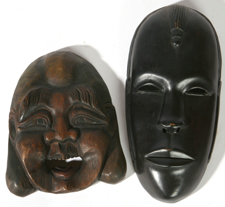 TWO CARVED WOODEN MASKS