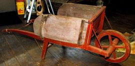 EARLY WOODEN WHEELBARROW