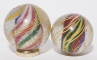 TWO SOLID CORE SWIRL MARBLES