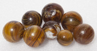 EIGHT AMBER SLAG MARBLES