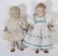 TWO ALL BISQUE JOINTED DOLLS