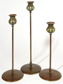 THREE GRADUATED TIFFANY STYLE BRONZE & GLASS CANDLESTICKS