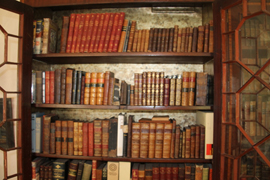 SEVERAL EARLY LEATHER BOUND BOOKS