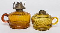 Two Amber Glass Finger Lamps
