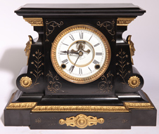 ORMOLU MOUNTED AMERICAN IRON CLOCK