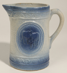 Blue and White Stoneware Cow Pitcher