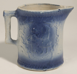 Blue and White Stoneware Pitcher With Children