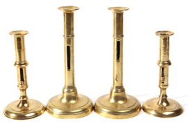 Four 19th Century Brass Push Up Candlesticks