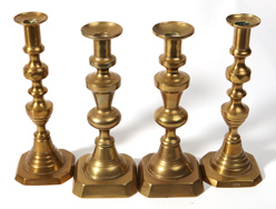 Two Pair of Victorian Brass Candlesticks