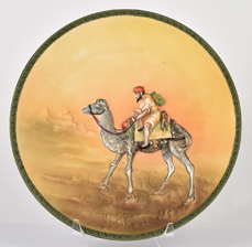 Nippon Molded in Relief Man on Camel Plaque